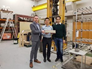 Image caption: Damian Crough, Assoc Prof Tuan Ngo and Dr Ali Kashani in the lab with a block of glass-impregnated concrete